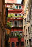 Street in Rome. Bright colored houses in old Rome Stock Photo