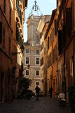 Street in Rome. Street in city center of Rome, traditional italian buildings. Church in the background. Typical scenery Stock Photography