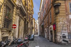 Street in Rome with an image of The virgin with child on the facade corner royalty free stock photography