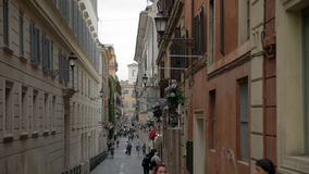Street in Rome, Italy. Visitors walking down the streets somewhere in Rome, Italy stock video
