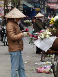 Street rose and flower-cutters & trimmers in Vietnam Royalty Free Stock Photo