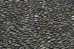 Street round roller-Pebble stone Royalty Free Stock Image