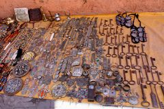 Street sale of keys, traditional jewelry and bags in old city of Marrakesh. Marrakesh, a former imperial city in western Morocco, is a major economic center and royalty free stock image