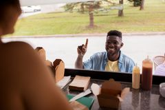 African american man ordering wok at food truck Royalty Free Stock Photography
