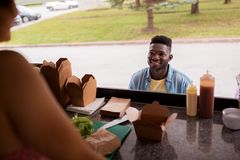 African american man ordering wok at food truck Royalty Free Stock Images