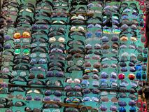 Street sale of shades for your eyes. Road side traders in Zanzibar`s Stone Town selling multicolour sunglasses with attractive sun and eye catching lenses Stock Photo