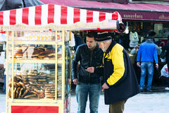 Street sales of traditional Turkish bagels Simit, Stock Image