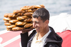 Street sales of traditional Turkish bagels Simit, are on the streets of Istanbul in Turkey Royalty Free Stock Image