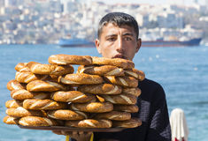 Street sales of traditional Turkish bagels Simit, are on the streets of Istanbul in Turkey Stock Photo