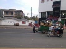 Street sanitation workers hauling garbage Stock Images