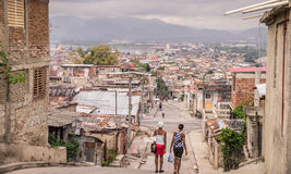 Street in Santiago de Cuba. Santiago de Cuba, Cuba on January 4, 2016: Women walking down street in poor residential area Stock Photography