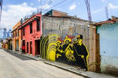 Street scene with street art in San Cristobal de las Casas, Mexico. San Cristobal de las Casas, Mexico - March 26, 2015: Street scene with street art on wooden royalty free stock images