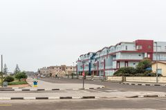 Street scene with beach facing holiday apartments in Swakopmund. SWAKOPMUND, NAMIBIA - JUNE 30, 2017: A street scene with beach facing holiday apartments in Stock Images