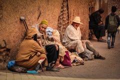 Street scene. Beggars. Marrakesh. Morocco. A street scene.group of beggars near a mosque. Marrakesh. Morocco royalty free stock photo