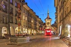Street scene in Bern, Switzerland. Night scene along Kramgasse in the old town of Bern Berne, Berna, Switzerland featuring the Zytglogge Clock Tower royalty free stock image