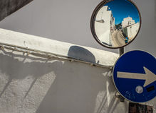 Street scene with blue highlights. And streetsigns and mirror Stock Image