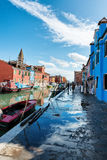 Street scene with a canal in Burano, Italy Royalty Free Stock Photo