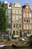Street scene with canal houses in Amsterdam Royalty Free Stock Photo