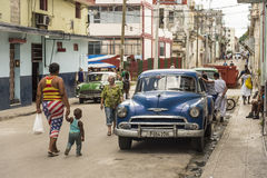 Street scene Central Havana. Street scene with people and parked old cars in residential area Central Havana, Cuba Royalty Free Stock Image