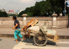 Street scene in China. Typical chinese street scene: woman is carrying rubbish to recycle Royalty Free Stock Images