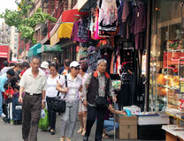 A street scene in chinatown,nyc. Busy street of shoppers and visitors Stock Photo
