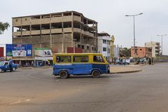 Street scene in the city of Bissau with a bus toca-toca in a roundabout near the Bandim Market, in Guinea-Bissau,. Bissau, Republic of Guinea-Bissau - January 28 Royalty Free Stock Photo