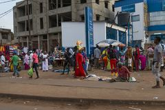 Street scene in the city of Bissau with people at the Bandim Market, in Guinea-Bissau Royalty Free Stock Photo