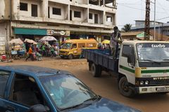 Street scene in the city of Bissau with people at the Bandim Market, in Guinea-Bissau, West Africa stock image