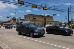 Street scene in the city of Giddings in the intersection of U.S. Highways 77 and 290 in Texas. Giddings, Texas - June 14, 2014: Street scene in the city of stock photography