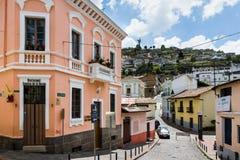 Street scene in the colourful La Ronda area of historic Quito, Ecuador with the famous winged Virgin Mary statue stock image