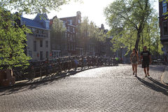 Street scene with couple in Amsterdam Stock Image
