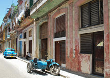 Street Scene in Cuba. Street Scene in Havana Cuba, with Antique car and motorcycle sidecar Royalty Free Stock Photography