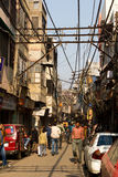 Street Scene in Delhi, India. With overhead electrical wires stock photography