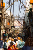 Street Scene in Delhi, India. With overhead electrical wires royalty free stock photo