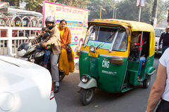 Street Scene in Delhi, India. With Tuc-tic in Traffic royalty free stock photo