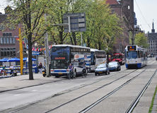 Street Scene Downtown, Amsterdam. Travel by public bus is popular in Amasterdam Royalty Free Stock Photos