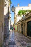 Street Scene, Dubrovnik. DUBROVNIK, CROATIA - JUNE 27, 2015: Street scene in the old city, with locals and tourists, in Dubrovnik, Croatia Stock Photos