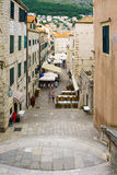 Street Scene, Dubrovnik. DUBROVNIK, CROATIA - JUNE 28, 2015: Street scene in the old city, with locals and tourists, in Dubrovnik, Croatia Royalty Free Stock Photos