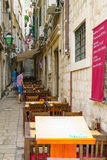 Street Scene, Dubrovnik. DUBROVNIK, CROATIA - JUNE 28, 2015: Street scene in the old city, with locals and tourists, in Dubrovnik, Croatia Royalty Free Stock Images