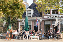 Street scene of Franeker city in Friesland, Netherlands. People on outdoor terrace of cafe on Breedeplaats square in the city of Franeker, Friesland, Netherlands Royalty Free Stock Photography
