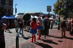 Street scene with girls in costume at the festival Royalty Free Stock Photography