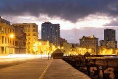 Night scene in Havana at the Malecon seaside avenue. Street scene in Havana on the Malecon seaside avenue at night Stock Photo
