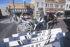 Street scene with horse drawn carriage on Beale Street in Memphis, TN Royalty Free Stock Photos