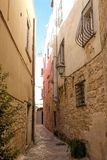 Street scene in the Jewish Quarter of the historic medieval town of Trani in Puglia, Italy royalty free stock photography