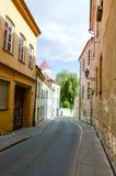 Street scene in Lithuania. Cobblestone Street in Vilnius, Lithuania Royalty Free Stock Image