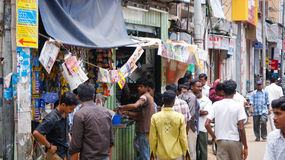 Street scene in Madurai, India. Men gather outside of a coffee shop in Madurai, Tamil Nadu, India Stock Photography