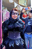 Street scene with masked Goth woman being photographed in Whitby. stock images