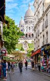 Street scene in Montmartre with the Sacre Coeur Basilica on the background Stock Photo