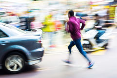 Street scene in motion blur. Street scene with car and running man in motion blur Royalty Free Stock Images