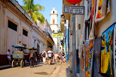 Street scene next to the famous Bodeguita del Medio in Old Havan. HAVANA,CUBA- MARCH 15,2016 : Colorful street scene next to the famous Bodeguita del Medio and Royalty Free Stock Image
